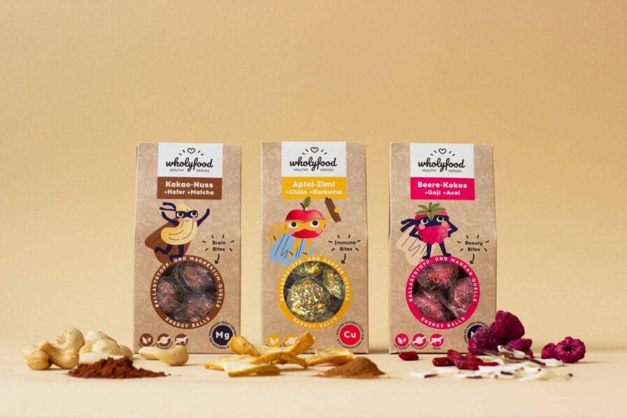Produktbild Verpackungen der wholyfood Energy Balls mit Zutaten